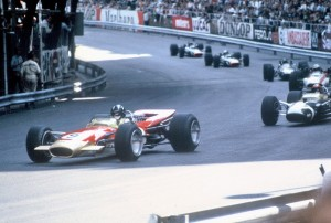 Graham Hill leads the 1968 Monaco Grand Prix in the Gold Leaf Lotus 49 (Chassis R5)