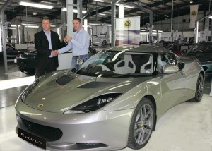 Luke Bennett, Director of Lotus Cars (left) hands over the keys of the first customer Lotus Evora to Mr Matthew Melling at the Lotus Headquarters in Norfolk, UK.